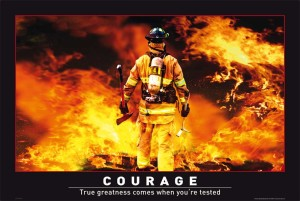 firefighter walking into flames with courage caption
